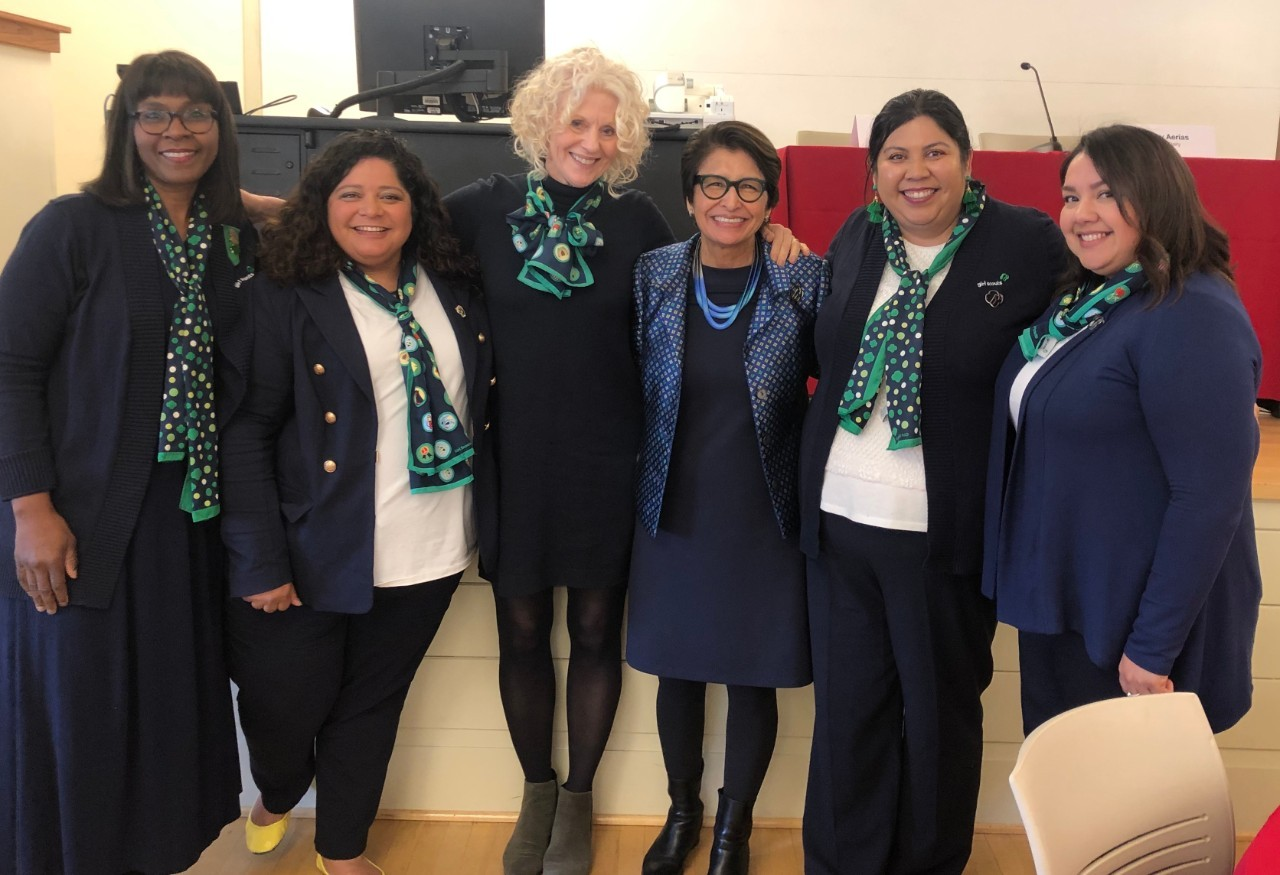 Team of Girl Scouts Hearts of Central California women smiling.