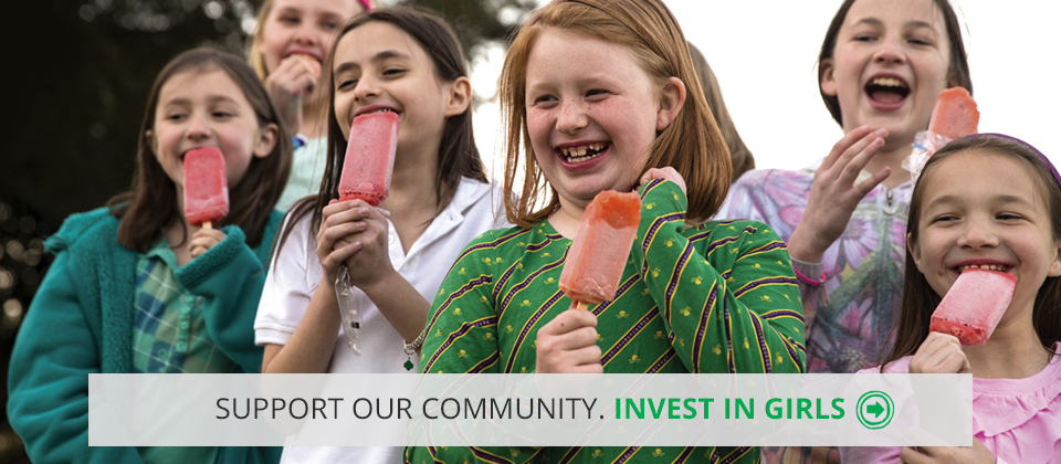 "Image of girls smiling with popsicles with the words ""Support our community. Invest in girls"""